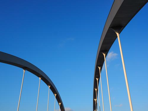Bridge arches abstract in front of blue sky Germany Europe Manmade structures Architecture Exceptional Modern Blue Esthetic Perspective Surrealism Dynamics