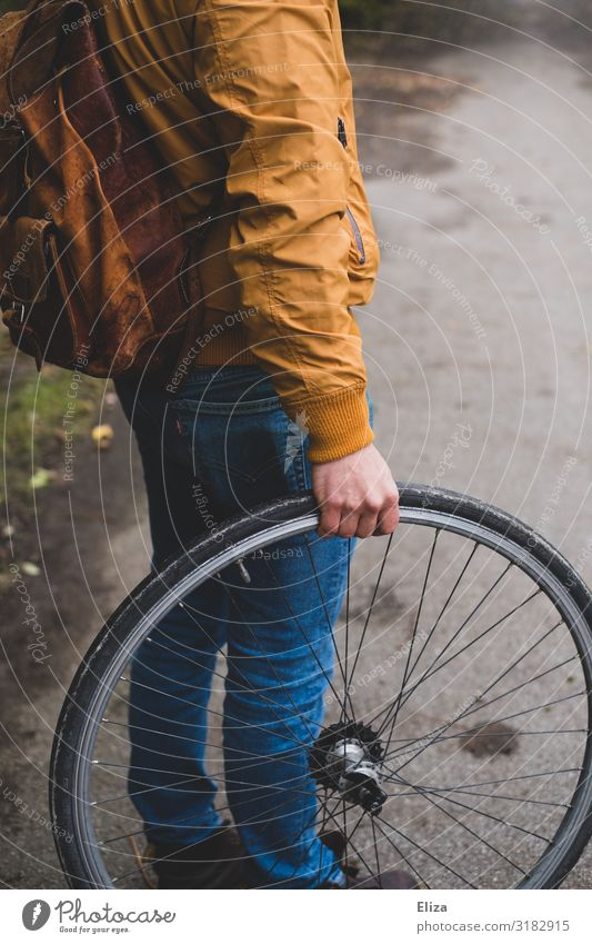 Man with a wheel Bicycle Human being Masculine Young man Youth (Young adults) Adults 1 18 - 30 years Environmental protection Wheel Tire Bicycle tyre Autumn