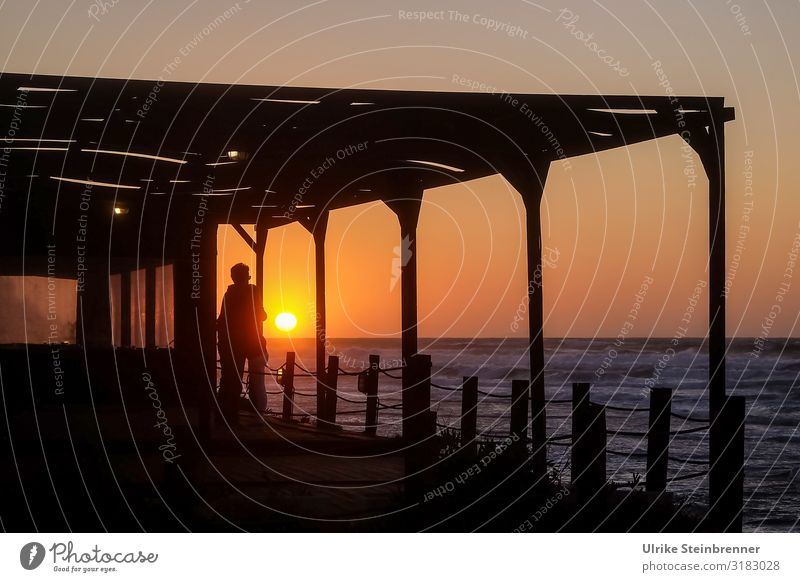 Couple in hug at sunset by the sea Man Woman Sunset evening mood Ocean Coast Terrace Evening Infatuation Love Together Sympathy Happy Emotions Embrace Warmth