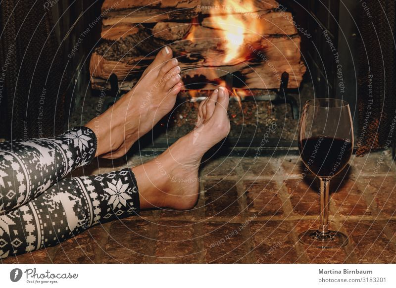 Woman resting with glass of red wine near fireplace Christmas & Advent Red Hand House (Residential Structure) Relaxation Winter Dark Lifestyle Adults Warmth