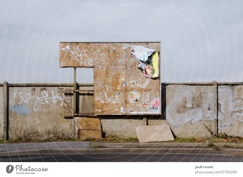 Broken billboard on an ugly wall Street art Pankow Wall (barrier) Sidewalk Billboard Dirty Hideous Trashy Apocalyptic sentiment Symmetry Decline Transience