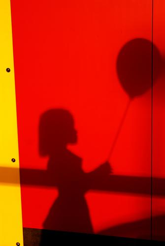 My balloon Human being Feminine Child Girl Infancy 1 Happiness Bright Warmth Yellow Red Black Balloon Colour photo Multicoloured Exterior shot Deserted Day