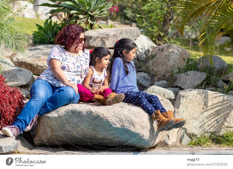 Cute family of mother and daughters in the garden Woman Child Human being Beautiful Green Joy Girl Face Lifestyle Adults Love Feminine Emotions