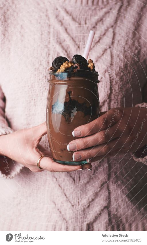 Crop woman with jar of chocolate mousse Woman Chocolate Dessert Milkshake Glass Delicious Food Drinking Cold Mousse Fresh Sweet Nutrition Beverage Sweater Pink
