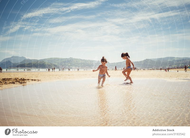 little girls by the seashore Beach Family & Relations Child Splash Joy Summer Happy Vacation & Travel