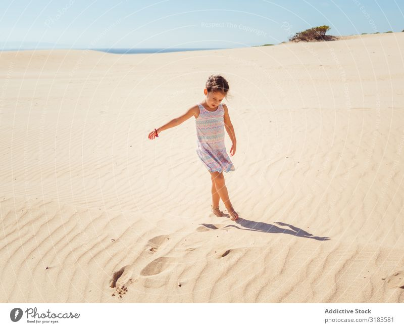 Cute little girl playing with sand at beach Sand Beach Girl Child Small Playing Summer Vacation & Travel Ocean Youth (Young adults) Exterior shot Beautiful