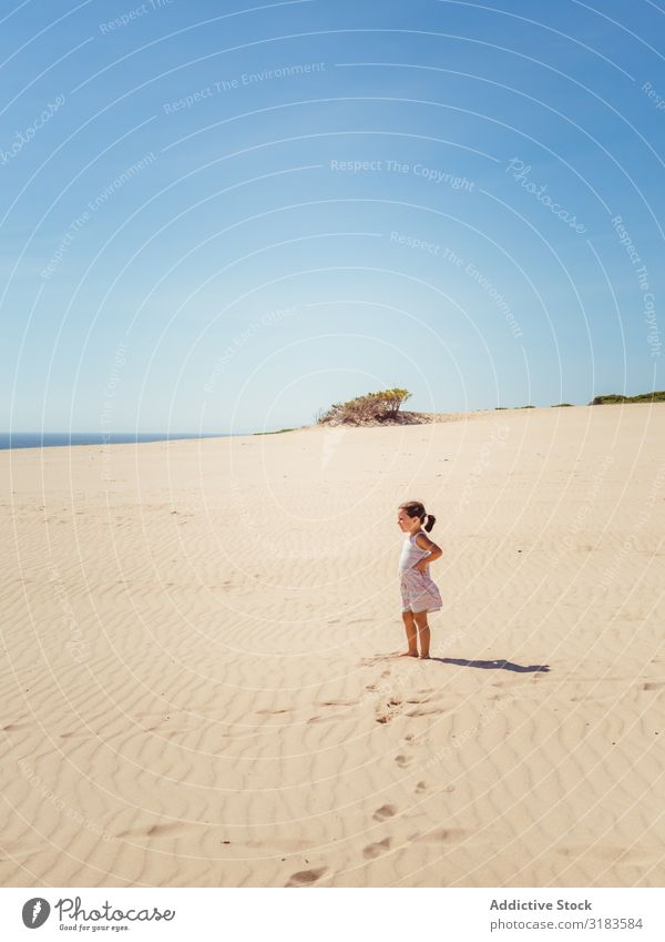 Cute little girl standing at sand dune Sand Beach Girl Child Small Playing Summer