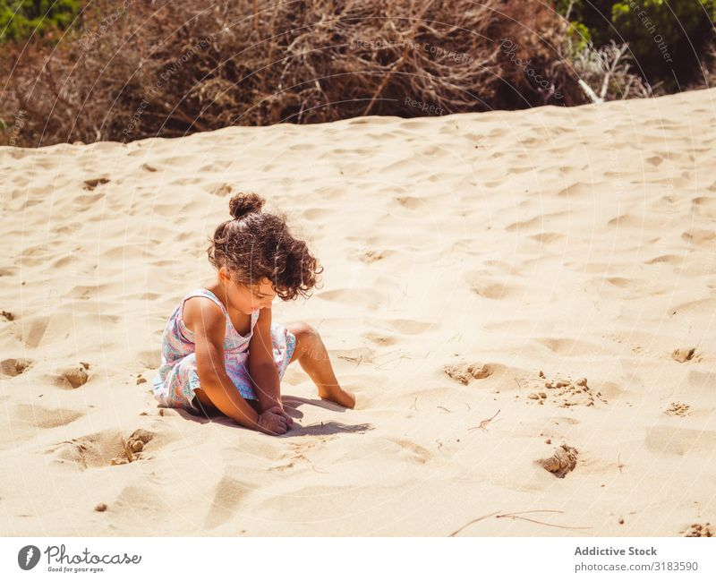 Cute little girl playing with sand at beach Girl Walking Beach Sand Child Small Playing Summer Vacation & Travel Ocean Youth (Young adults) Exterior shot