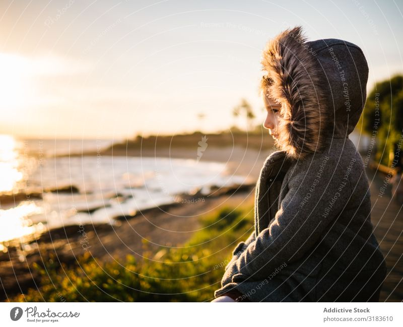 pensive girl at beach on winter Girl Child Pensive Winter Beach Ocean exploration Spring Day Nature Vacation & Travel Cold Small Autumn Human being Water