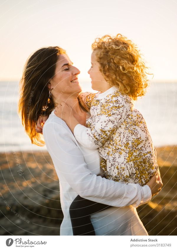 Mother with her daughter at beach Family & Relations Beach seaside Vacation & Travel Child Smiling Embrace Woman Middle-aged Daughter Girl Together Ocean Summer