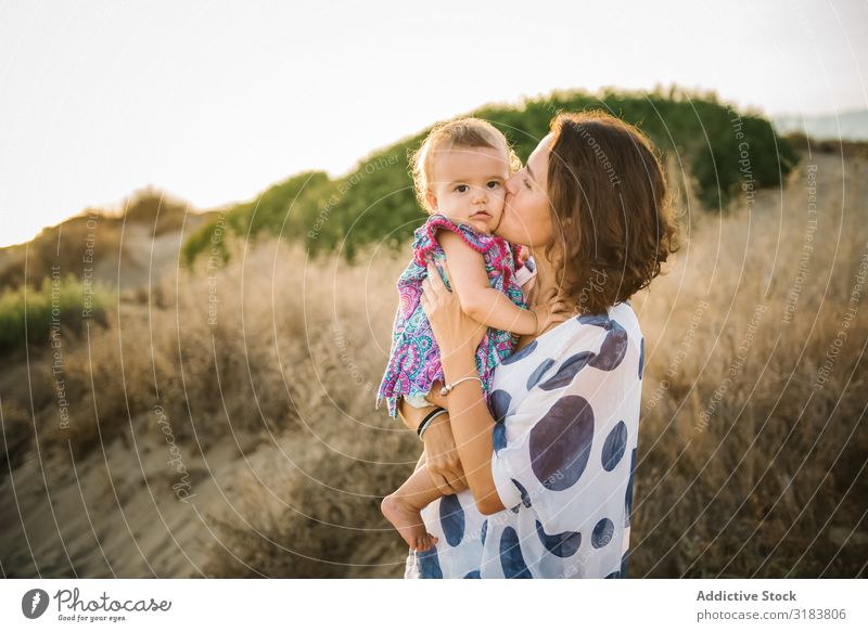 Mother holding child Woman Child Hold Son Beach Sand Vacation & Travel Ocean