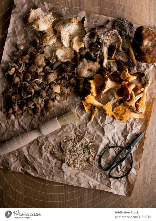 Brush and scissors near dried mushrooms Mushroom Dried parchment Paper Scissors Table Ingredients Food Natural Edible Fresh Vegan diet Healthy Organic Diet