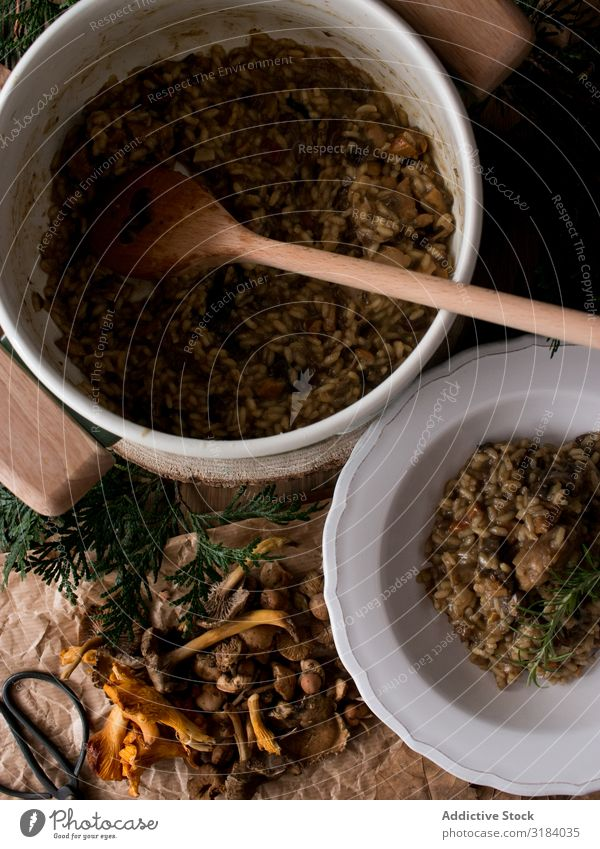 Rosemary on risotto with rabbit and mushrooms Rice Hare & Rabbit & Bunny Mushroom Plate Table Kitchen Rustic Dish Dinner Food Meat Italian Herbs and spices