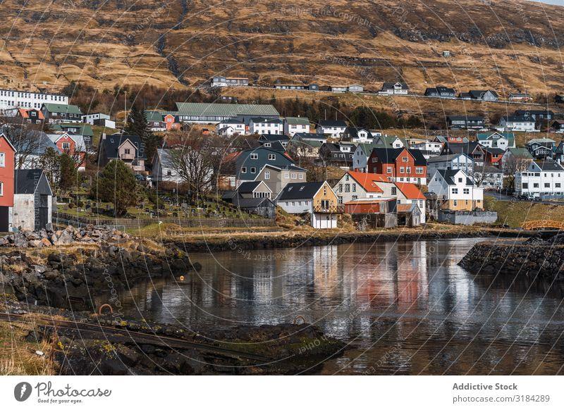 Small settlement near hill Town Hill Landscape House (Residential Structure) Føroyar Exterior Weather Sky Settlement Village cottages Rock Mountain Peak