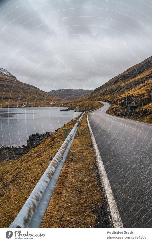 Winding road on hilly terrain Street Hill Landscape Clouds Sky Føroyar Vacation & Travel Asphalt Weather Nature Rural Deserted Lanes & trails way Track