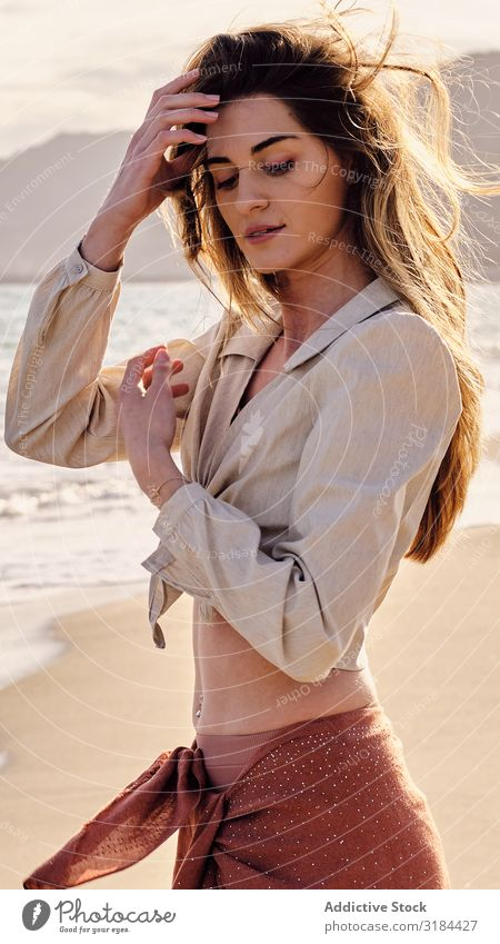 A fashion model at the beach before sunset Brown Hair Lifestyle Beautiful Woman Seductive Women Tranquil Scene Adults Only One Woman Only Bikini Comfortable