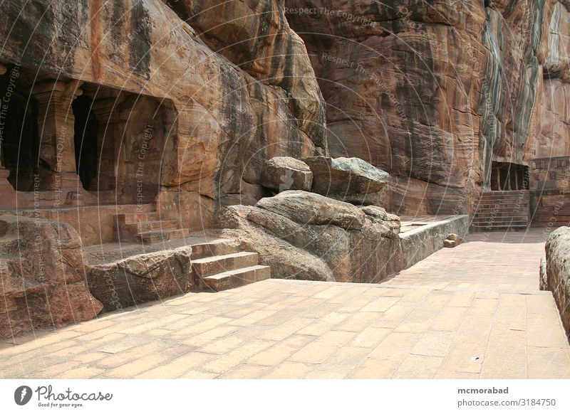 Rock Temples Vacation & Travel Tourism Building Architecture Monument Stone Gigantic Brown Red Cave place of worship rock-cut figures Statue Column construction