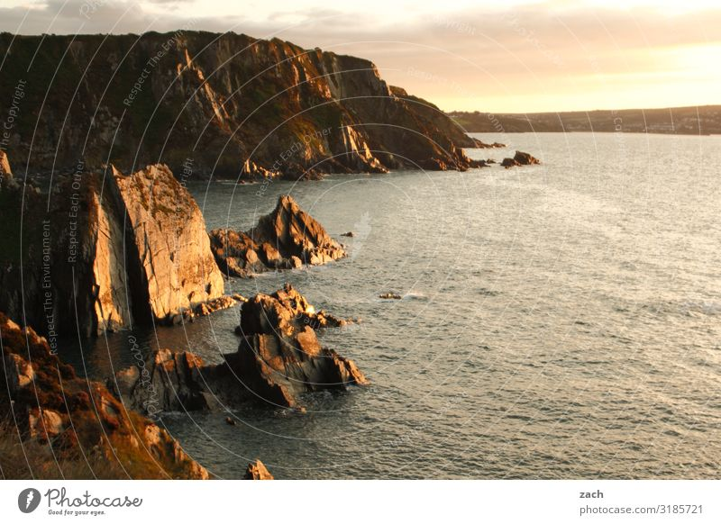 At the end of the day. Landscape Water Sunrise Sunset Beautiful weather Hill Rock Waves Coast Ocean Island British Isles Great Britain Wales Irish Sea