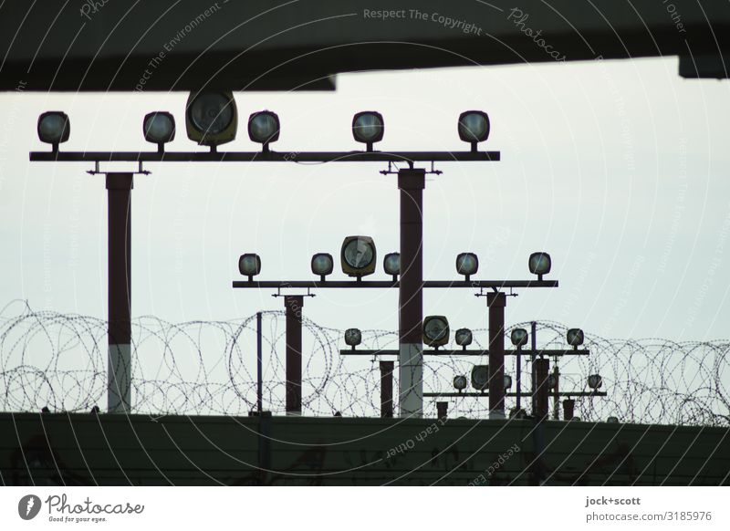 hint of light Aviation Sky Traffic infrastructure Landing strip lights Lamp Retro Under Many Moody Safety Symmetry Target Barbed wire Light blue Subdued colour