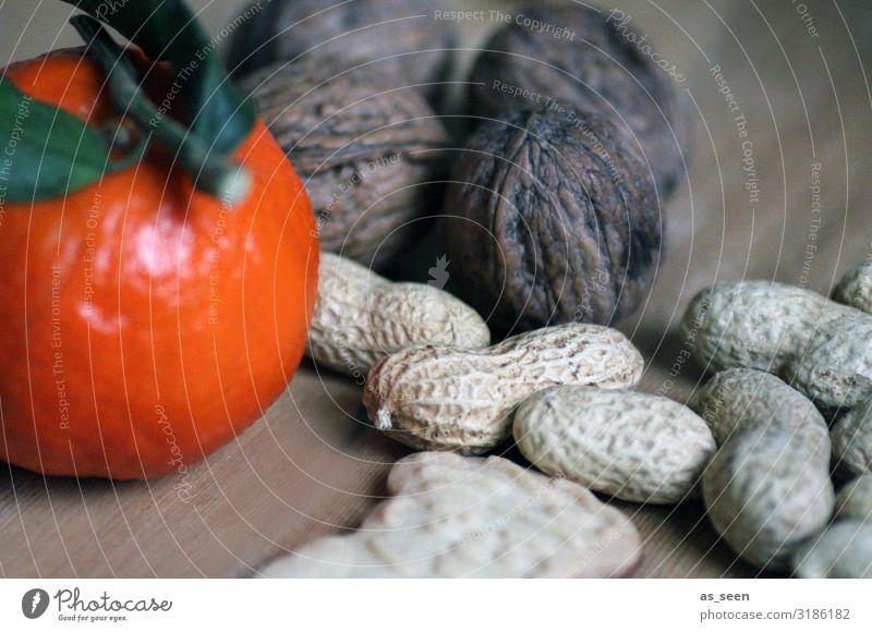 Nut and almond kernel Food Orange Peanut Walnut Tangerine Leaf Nutrition Vegetarian diet Slow food Plate Lifestyle Wellness Calm Flat (apartment)