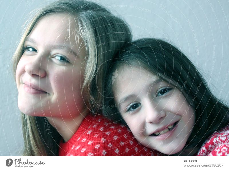 sisters Girl Sister Infancy Youth (Young adults) Face 2 Human being 8 - 13 years Child 13 - 18 years Fashion Sweater Hair and hairstyles Black-haired Blonde