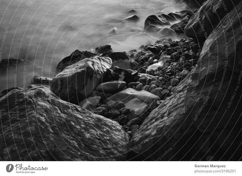 Stones in the beach Nature Landscape Elements Earth Water Summer Waves Coast Beach Bay Infinity Beautiful Wet Natural Speed Gloomy Wild Black White Silken