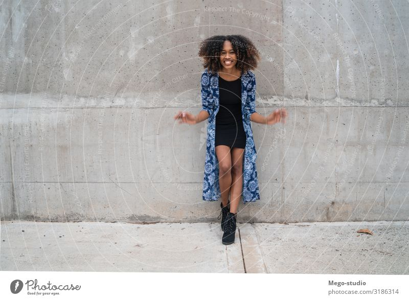 Afro-american woman against grey wall. Style Happy Beautiful Face Human being Woman Adults Fashion Clothing Brunette Smiling Stand Cool (slang) Friendliness