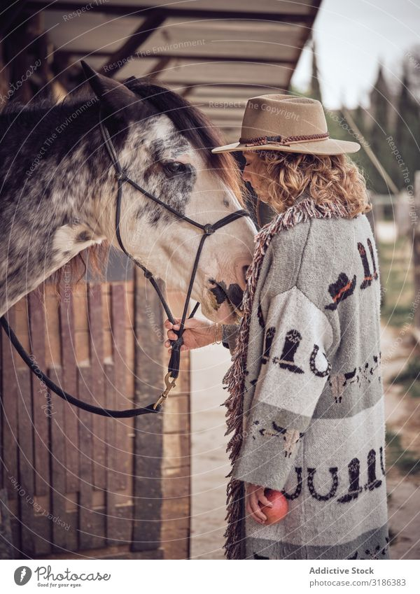 Beautiful cowgirl with horse Woman Horse Ranch Stable Closed eyes Touch Head Animal