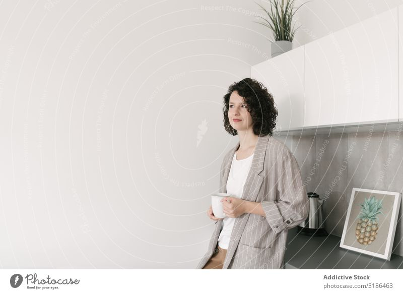 Pensive woman at home Woman pretty Home Youth (Young adults) Cup delighted Drinking Looking away Smiling Beautiful Lifestyle Beauty Photography Attractive