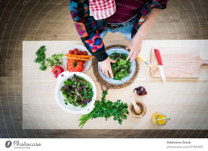 Woman preparing vegetable salad Salad Vegetable Stir Kitchen Home Healthy Food Vegetarian diet Diet Nutrition Fresh Mature Meal Dish Vegan diet spatulas Oil