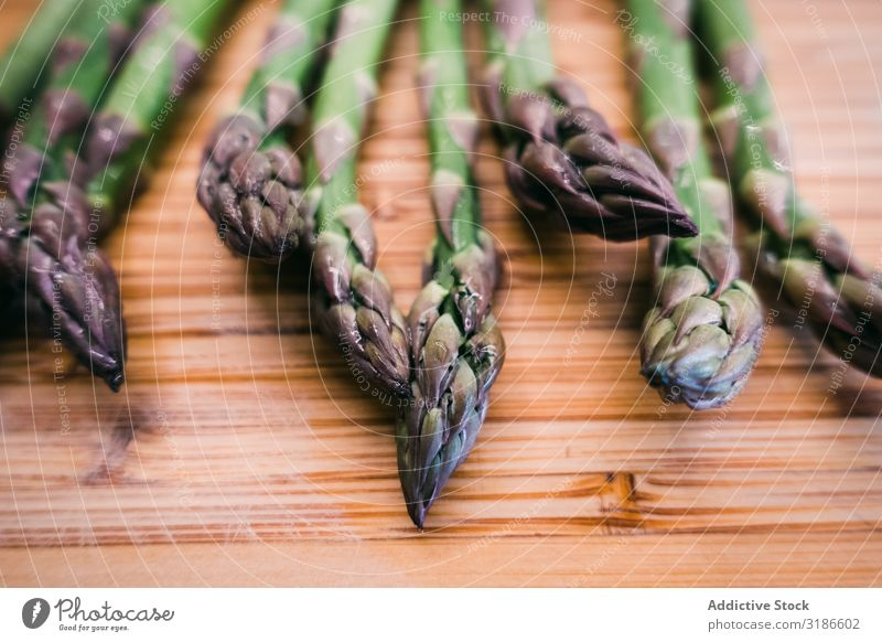 A bunch of green asparagus on wooden surface Asparagus Vegetable Surface Wood Ingredients Green Fresh Diet Food Organic Healthy Vegetarian diet Nutrition