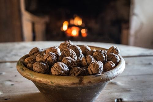 Bowl of nuts on table in old cottage Old House (Residential Structure) Nut Fireplace Comfortable Kitchen Interior design Cottage Village Landscape Rural Ancient