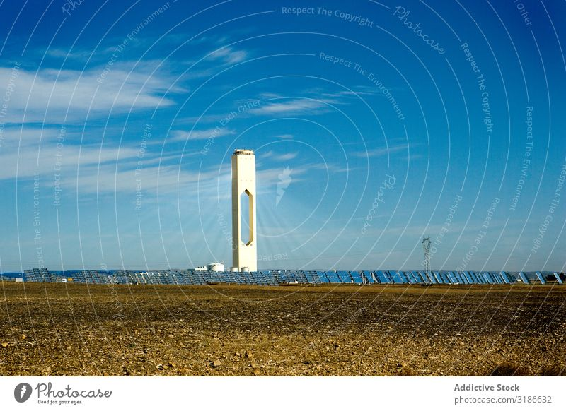 Tall tower in photovoltaic power station Solar Power Panels Station Tower Sky Clouds Sunbeam Day Energy Electricity Technology Building Weather Ecological