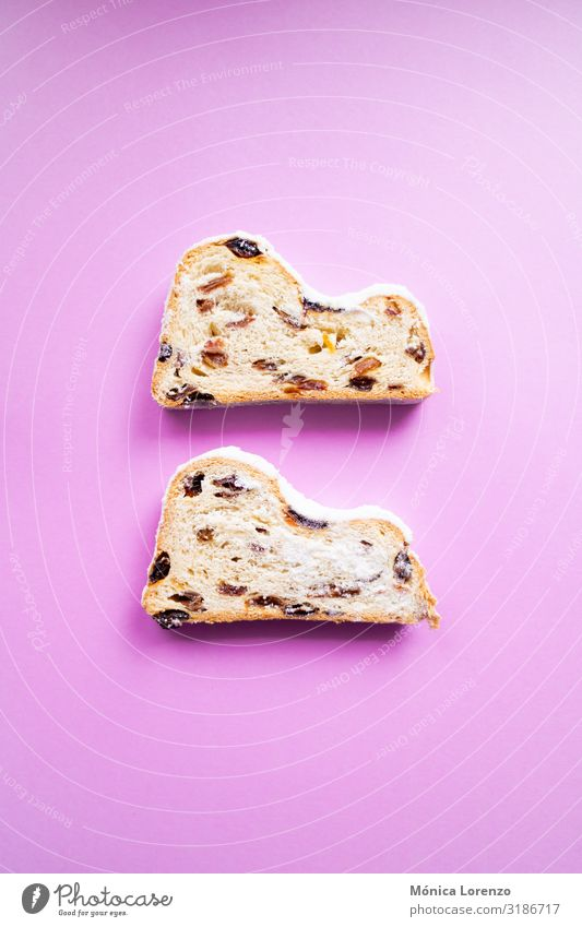 Stollen slices on pink background. Fruit Bread Dessert Herbs and spices Winter Feasts & Celebrations Pink Tradition blogging Sugar ginger Cinnamon anise recipe