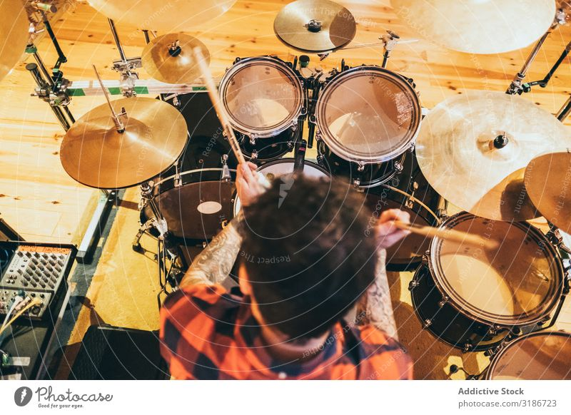 Musician playing drum Man Drummer Playing instrument Lifestyle Sound Concert drumsticks Artist Song Entertainment Joy Performance Rock Creativity