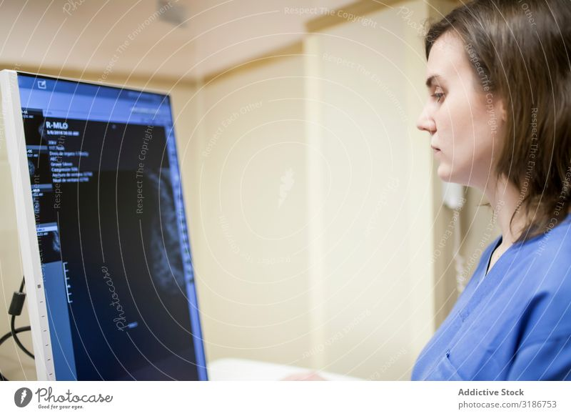 Female doctor using digital equipment for mammography Doctor Equipment Digital examining Woman diagnosing Uniform Medication Professional Display Screening