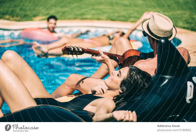 Men and women relaxing in poolside Swimming pool Friendship Guitar Playing instrument Woman Man airbed handsome Happy Cheerful Inflatable Fish Toys Rest Summer