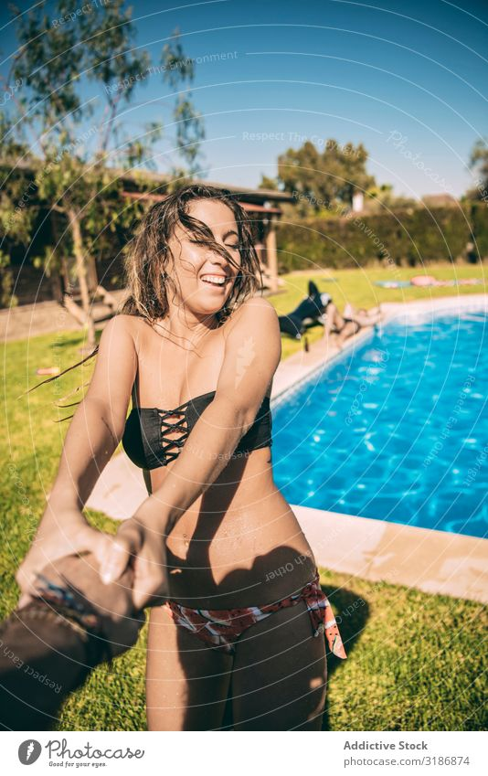 Woman holding of anonymous man follow me Swimming pool Playful Cheerful Summer Vacation & Travel Recklessness Couple Youth (Young adults) Together Joy Laughter