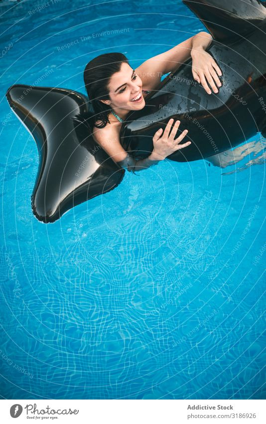 Girl with inflatable toy posing in water Posture Swimming pool Joy riding Inflatable Fish Toys Ride Water Happy Smiling pretty Beauty Photography Laughter