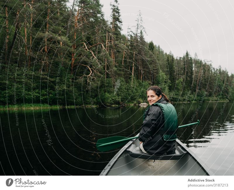 Woman boating on forest river in Finland River Vacation & Travel Lifestyle Summer Oar life vest Youth (Young adults) Watercraft Joy Human being Adventure