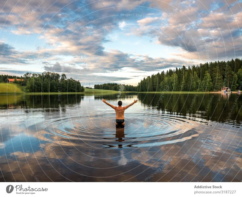 Man standing in water with opening hands Opening Arm Water Happy Vacation & Travel Leisure and hobbies Tourism Lifestyle Human being enjoyment Finland Swimming