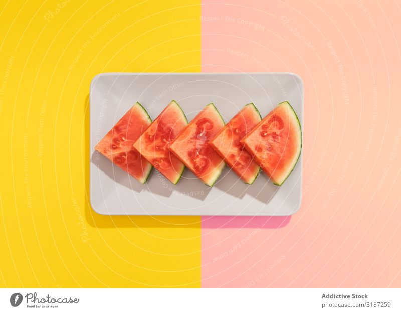 Watermelon on colorful background Water melon Fruit Healthy Tropical Exotic Colour Cut Seeds Red Background picture Summer Juicy pieces Multicoloured Vitamin