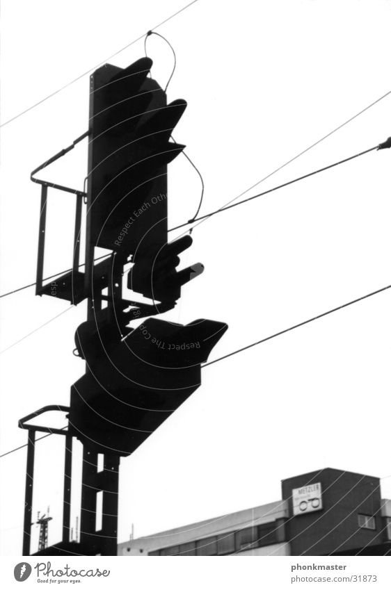 beacon Signal Traffic light Railroad Railroad tracks Transport Vacation & Travel High voltage power line silouette sillouette Black & white photo