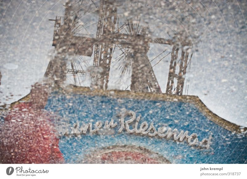 graphic | round trip Rain Puddle Vienna Capital city Tourist Attraction Landmark Ferris wheel Prater Famousness Historic Kitsch Retro Blue Gray Red Romance