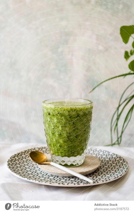 Healthy green smoothie detox Green Milkshake Detox Juice Drinking Spinach Food Fruit Vegetable Avocado Apple Vegetarian diet Organic super food Close-up Glass