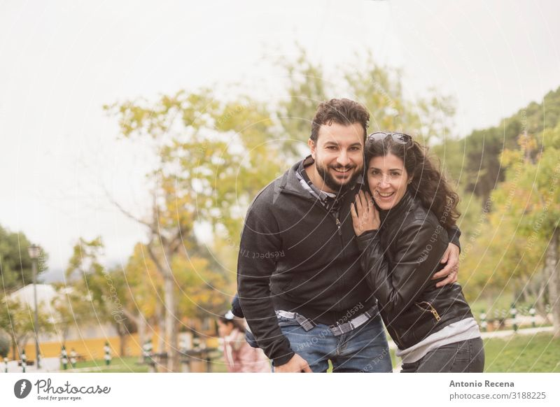30-40 years old Couple in park posing for a photo Lifestyle Happy Valentine's Day Human being Woman Adults Man Park Brunette Beard Smiling Laughter Love