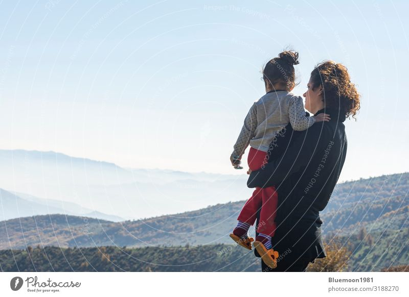 Mother with little daughter looking at mountains on vacation Woman Child Human being Vacation & Travel Nature Beautiful Landscape Relaxation Loneliness Calm Joy