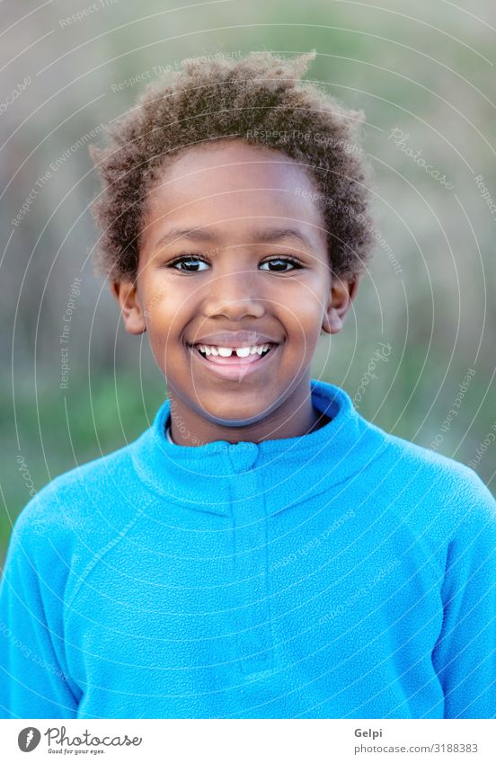 Happy african child with blue jersey Joy Relaxation Calm Leisure and hobbies Playing Child Boy (child) Infancy Autumn Park Meadow Afro Smiling Dream Happiness