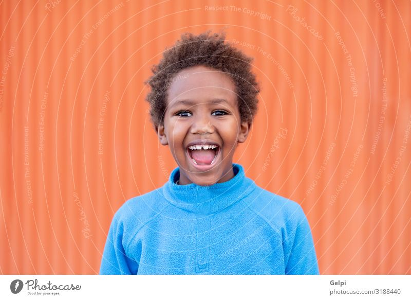 Funny african child with blue jersey Joy Relaxation Leisure and hobbies Playing Child Boy (child) Infancy Autumn Meadow Afro Smiling Dream Happiness Small Cute