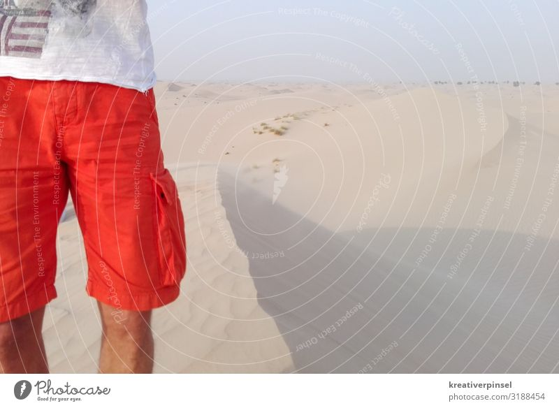 in the desert Human being Masculine Body Legs 1 30 - 45 years Adults Sand Sky Horizon Summer Beautiful weather Drought Desert Clothing T-shirt Pants
